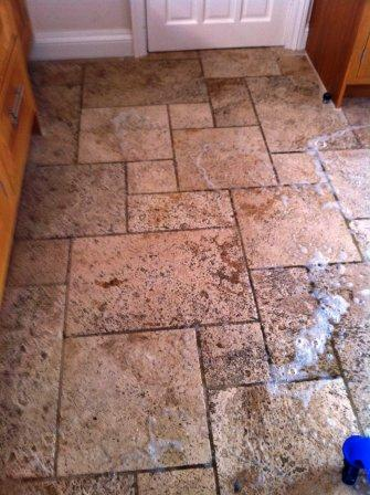 Dirty Travertine Floor During Washing