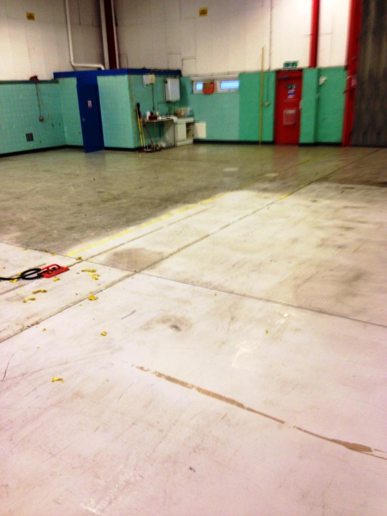 Factory floor degrease in progress
