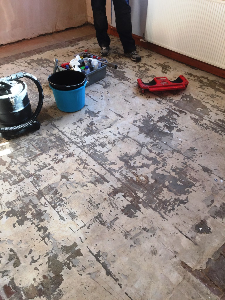 Quarry tiles covered in screed Marton before restoration