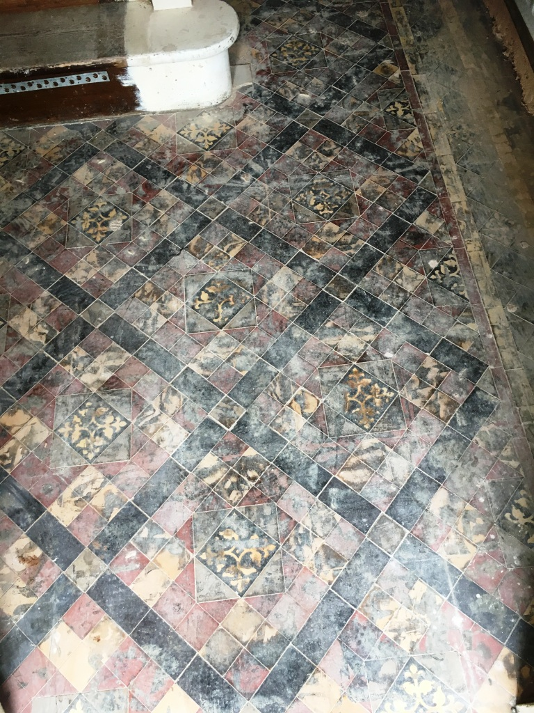 Removing tar from edwardian hallway tiles in warwickshire edwardian tiled floor covered in tar chaplefields coventry before restoration doublecrazyfo Gallery