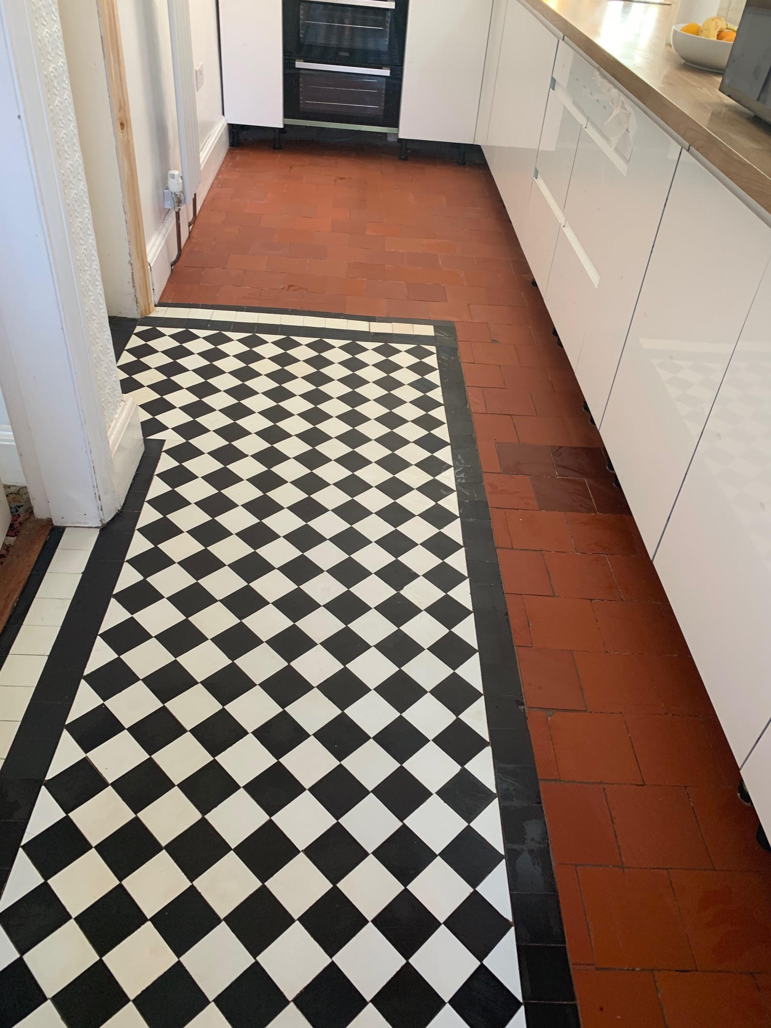 Quarry Tiled Kitchen Floor During Renovation in Rubgy